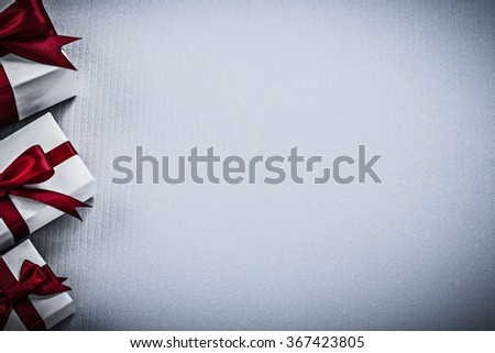 Wrapped giftboxes on white surface copy space holidays concept. - stock photo
