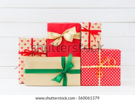 Wrapped gifts boxes  on white wooden background. Copy space  - stock photo