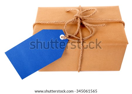 Wrapped package or parcel, blue gift tag or label isolated on white, side view, copy space - stock photo