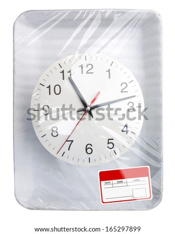 Wrapped plastic white food container with clock and blank label isolated - stock photo