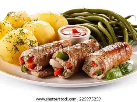 Wrapped pork chop, boiled potatoes and vegetables - stock photo