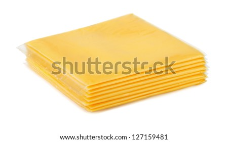 Wrapped processed sliced cheese isolated on white - stock photo