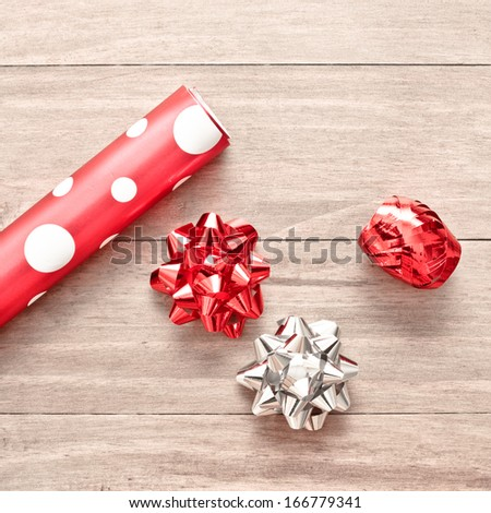 Wrapping paper,ribbon and bows for christmas - stock photo