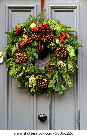 Wreath decoration at door for Christmas holiday - stock photo