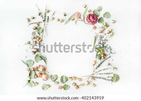wreath frame with roses, lavender, branches, leaves and petals isolated on white background. flat lay, overhead view - stock photo