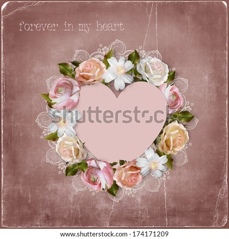 Wreath of flowers and heart on vintage background - stock photo