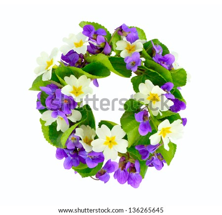 Wreath of woodland violets and primula. Isolated on white background. - stock photo