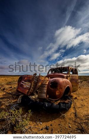 wreck in karoo landscape - stock photo
