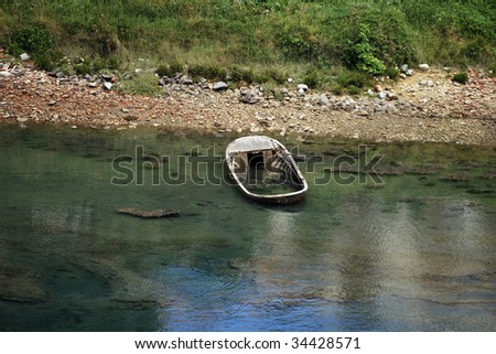 Wreck in the sea. Abandoned wooden boat - stock photo
