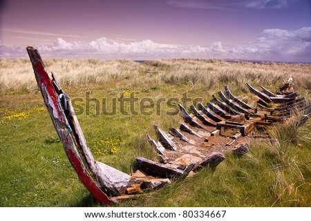 wreck of a traditional Irish rowing boat at the Dingle peninsula Ireland