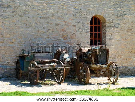 wreck of old tractors at outdoor - stock photo