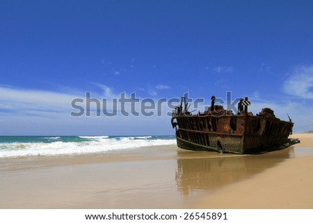 Wreck ship on a beach - stock photo