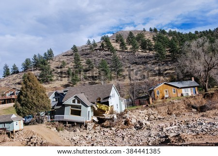 Wreckage, collapsed, flattened wooden houses caused from a tornado damage in the Northern of Colorado State, USA. - stock photo