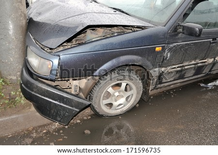 Wrecked car close-up. horizontal photo. - stock photo