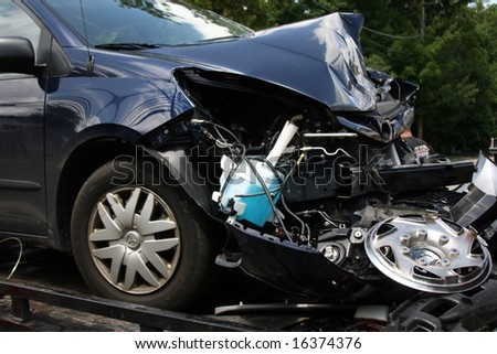 Wrecked Car seen on a Tow Truck - stock photo