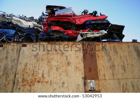Wrecked cars in a junkyard - stock photo