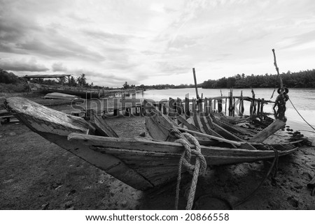Wrecked fishing boat in black and white