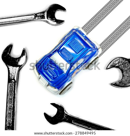 Wrench and Car for Car Maintenance or Repair Concept - stock photo