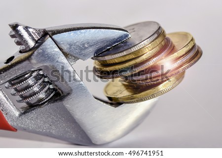 https://thumb7.shutterstock.com/display_pic_with_logo/3567263/496741951/stock-photo-wrench-and-coins-the-concept-of-a-permanent-and-stable-prices-496741951.jpg