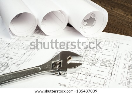 wrench and drawings are on the desktop, workspace engineer - stock photo