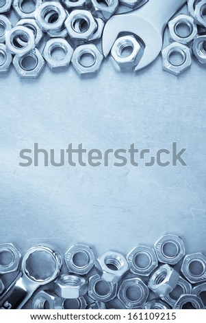 wrench and nut tool on metal  background texture - stock photo