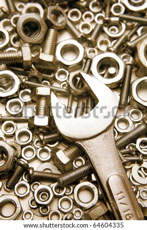 Wrench on nuts and bolts - stock photo
