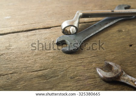 Wrench put on wood background.
