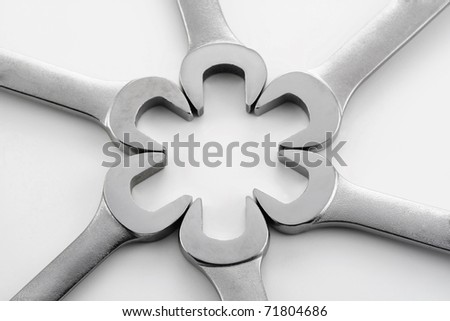 wrenches and hardware in various patterns on a white background