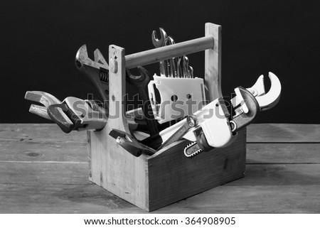 wrenches in wooden toolbox close up - stock photo