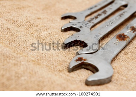 Wrenches on a fabric.
