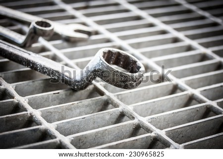wrenchs on plate background - stock photo