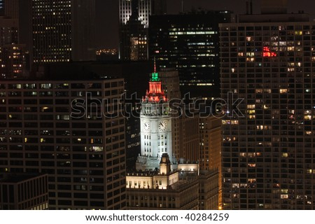 Wrigley Building in downtown Chicago, displaying Halloween colors on the clock tower - stock photo