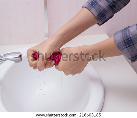 Wringing a cleaning rag. - stock photo