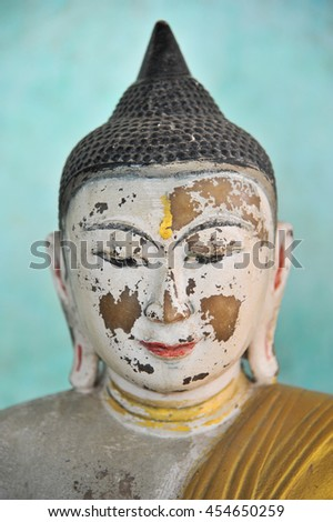 Wrinkle on Myanmar buddha statue - stock photo