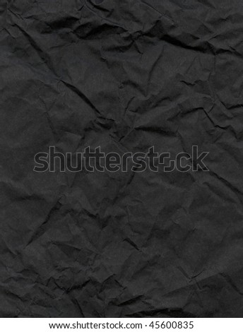 Wrinkled black material. - stock photo
