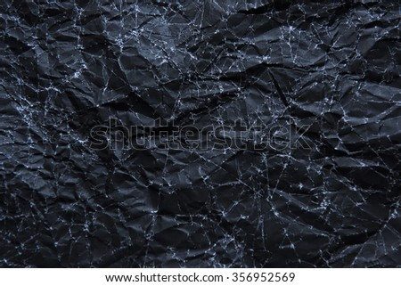 wrinkled black paper texture or background made from paper - stock photo