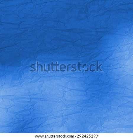 wrinkled blue paper, monochrome rough surface - stock photo