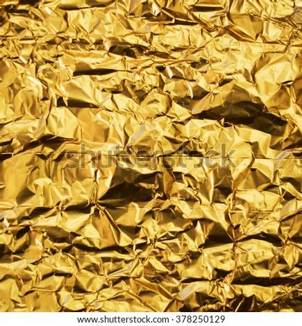 Wrinkled golden foil background - stock photo