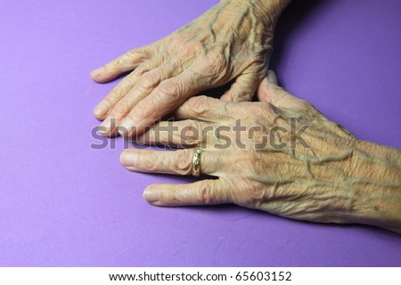 wrinkled hands of a ninety year old woman - stock photo