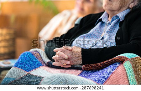 Wrinkled hands of old woman - stock photo