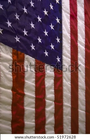 Wrinkled hanging American flag for a background. - stock photo