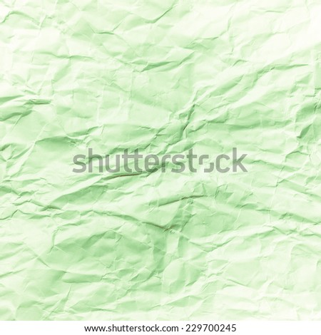 Wrinkled paper background. Green retro filter. - stock photo