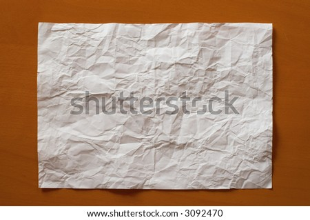 Wrinkled paper on a wood table