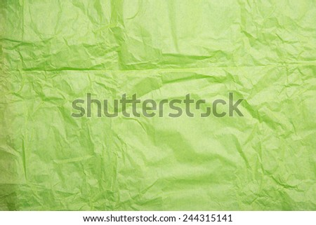 Wrinkled paper texture, green wrapping paper  - stock photo