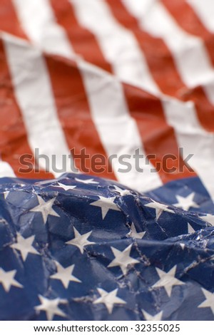 wrinkled paper USA flag, shallow depth of view, vertical photo - stock photo