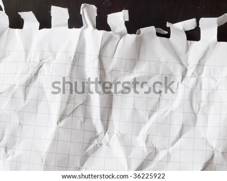 wrinkled piece of paper isolated on black - stock photo