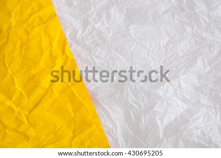 wrinkled torn paper - material sample - close up of textured background - stock photo