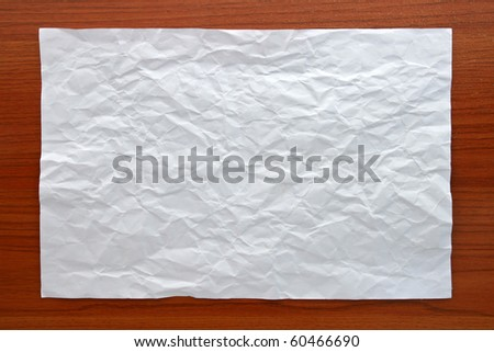 Wrinkled White paper attach on Wooden Board - stock photo