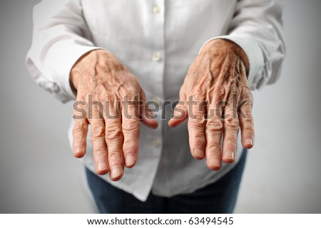 Wrinkled woman's hands - stock photo