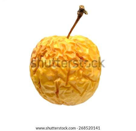 wrinkled yellow apple isolated on white background - stock photo